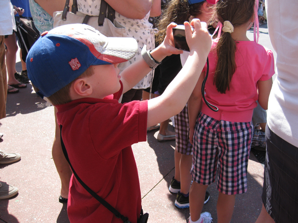 Nicholas taking a photo of the parade